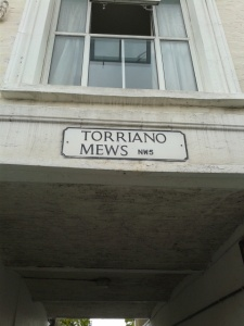 picture of a street sign reading Torriano Mews
